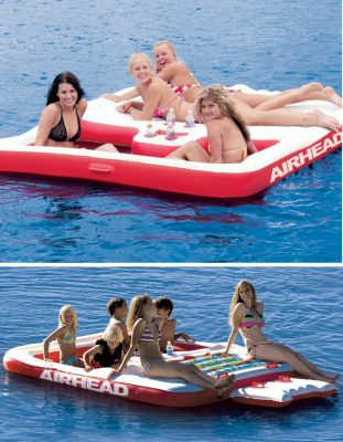 Kids sitting and enjoying the lake on this airhead cool island inflatable raft. It's more like a sun deck to lie down and dive from.