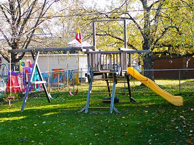 "A big swing set that includes a slide, swings and a ""tower"""