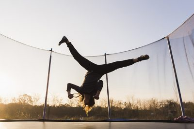 Are trampolines safe? Here are all the risks you need to be aware of when you have a backyard trampoline and what you can do to protect your kids.