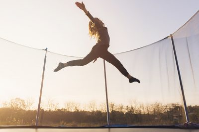 Trampolines for tumbling and gymnastics. Here are 3 of the highly-rated rectangular trampolines great for practicing tumbling and flips. Picture of girl jumping high on trampoline.